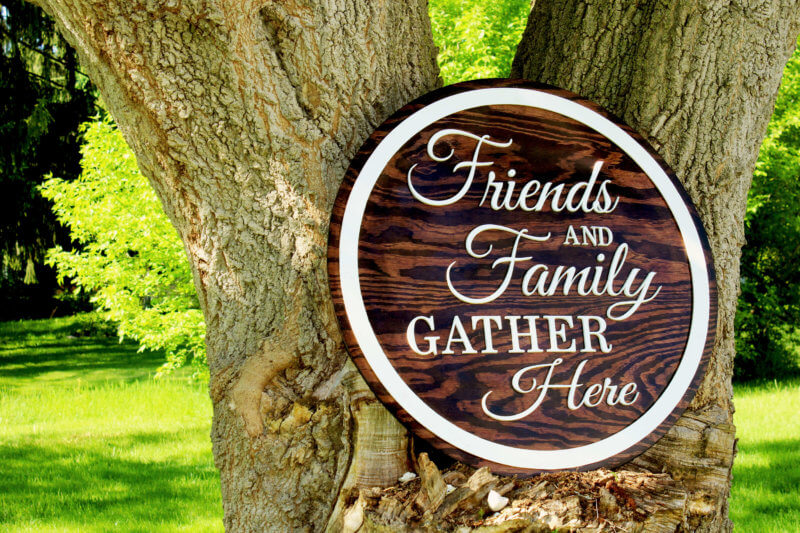 Four foot wooden sign reads Friends and Family Gather Here sign made for a family's pavilion in downstate NY.
