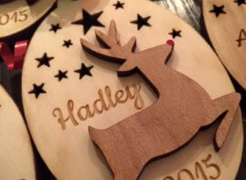 Reindeer laser cut on top of a oval shape cut with stars personalized